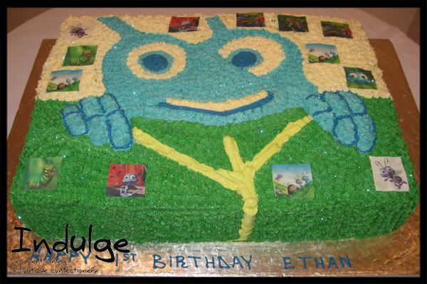 bugs life cake with cake cake childrens sponge cake with sugar paste icing and decorated with edible figurines