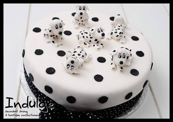 dalmations childrens sponge cake with sugar paste icing and decorated with edible figurines